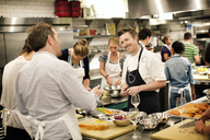 Chef teaching students at commercial kitchen - CAVF04515