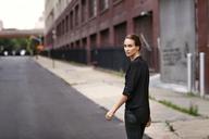 Portrait of woman walking on street - CAVF04683
