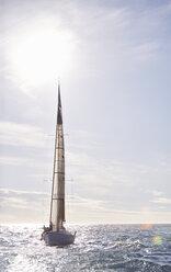 Sailboat on sunny ocean - CAIF09429