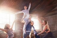 Young dancers dancing in studio - CAIF09489