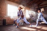 Young women hip hop dancers dancing in studio - CAIF09498