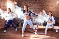 Young hip hop dancers with powder dancing in studio - CAIF09516