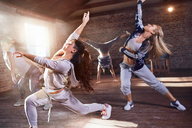 Young hip hop dancers with powder dancing in studio - CAIF09525