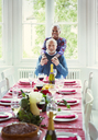 Portrait smiling multi-ethnic senior couple at Christmas dinner table - CAIF09561