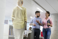Business people talking and walking in office - CAIF09726