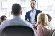 Businessman leading meeting in office - CAIF09768