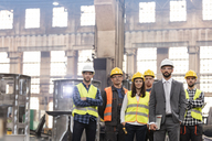 Portrait confident manager and steel worker team in factory - CAIF09786