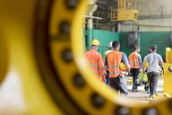 Steel workers walking in factory - CAIF09807