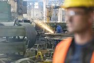 Welder using welding torch in steel factory - CAIF09864