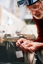 Focused male jeweler working in workshop - CAIF09894