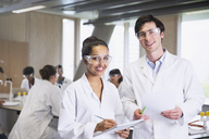 Portrait confident college students in lab coats in science laboratory classroom - CAIF10007