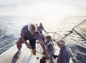 Retired friends sailing on sunny ocean - CAIF10148