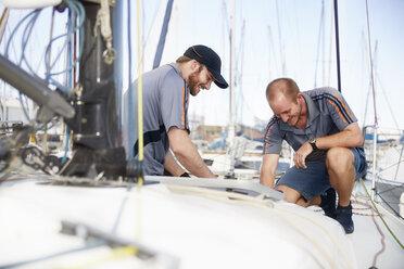 Men preparing sailboat - CAIF10157
