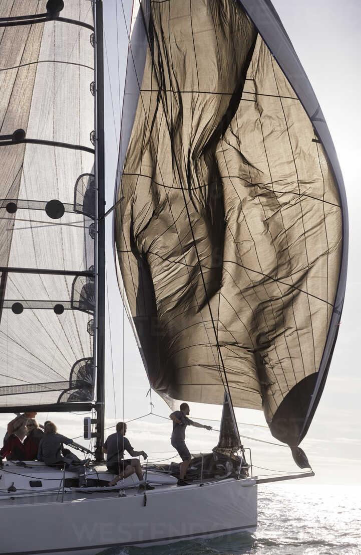Man adjusting sail on sailboat - CAIF10163 - Trevor Adeline/Westend61