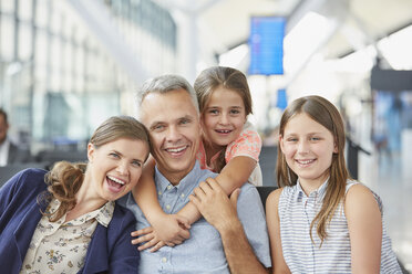 Portrait smiling family in airport departure area - CAIF10229