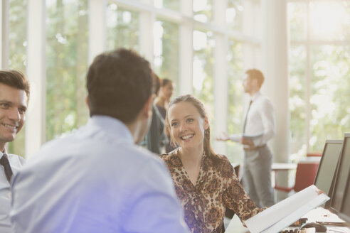 Smiling businesswoman in meeting - CAIF10433