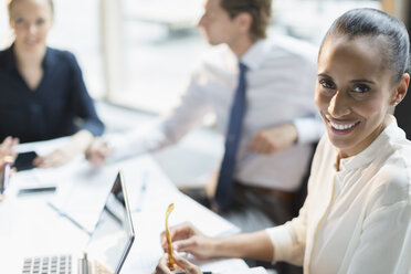 Portrait smiling businesswoman in conference room meeting - CAIF10439