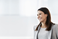 Smiling businesswoman looking away - CAIF10649