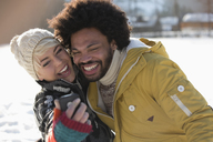 Happy couple taking selfie in snow - CAIF11006