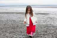 Girl in dress walking on beach - CAIF11063