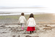 Girls walking on beach - CAIF11066