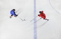 Overhead view hockey players going for puck on ice - CAIF11156