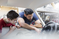 Father and son rebuilding classic car - CAIF11228