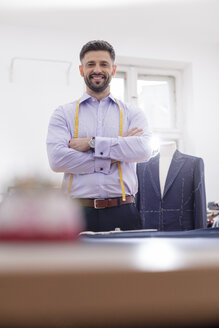 Portrait confident tailor in menswear shop - CAIF11276