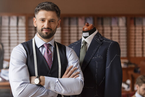 Portrait confident tailor in menswear shop - CAIF11294
