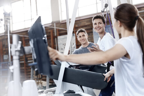 Physical therapists with man on treadmill - CAIF11342