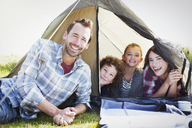 Portrait smiling family in tent - CAIF11510