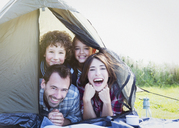 Portrait smiling family in tent - CAIF11528