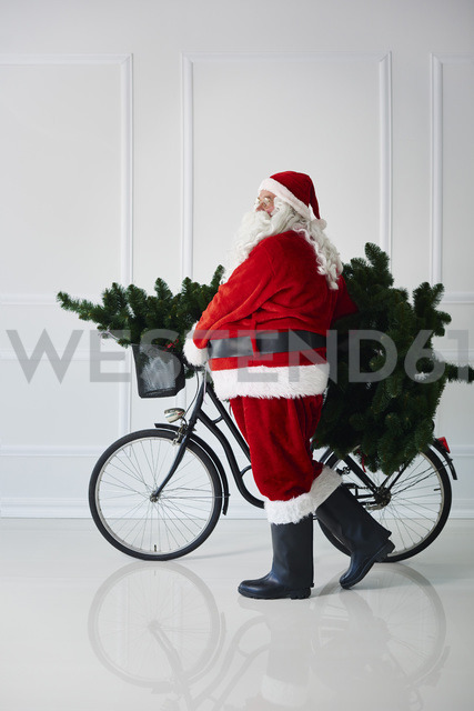 Santa Claus carrying with bicycle - ABIF00103