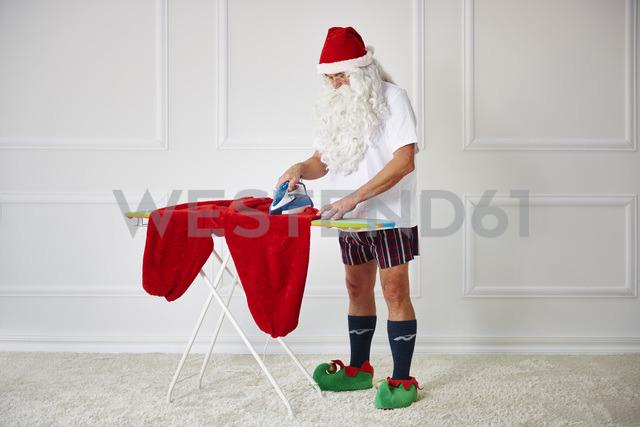Santa claus ironing his pants - ABIF00115