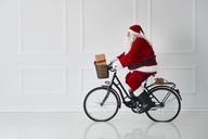 Santa Claus riding a bike - ABIF00124