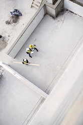 Overhead view of construction workers at construction site - CAIF11650