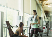 Women talking and resting at gym - CAIF11719