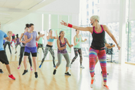 Fitness instructor leading aerobics class - CAIF11752
