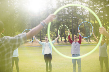 Group connected in circle by plastic hoops - CAIF11947