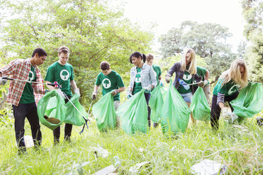 Environmentalist volunteers picking up trash - CAIF11995