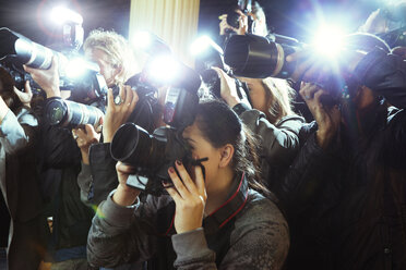 Paparazzi photographers photographing event - CAIF12031