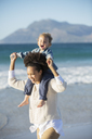 Mother and daughter playing on beach - CAIF12145