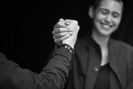 Young couple shaking hands - FMKF04968