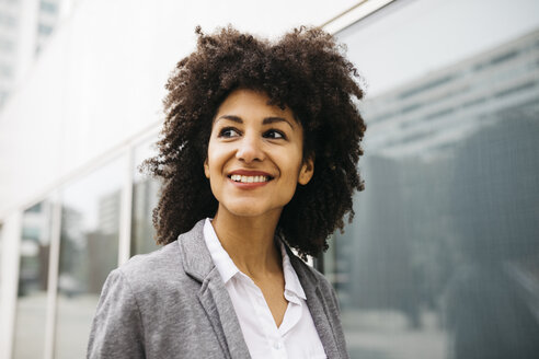 Portrait of happy woman with curly hair - JRFF01612