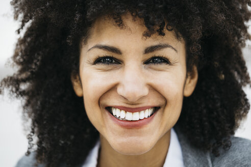Portrait of happy woman with curly hair - JRFF01618