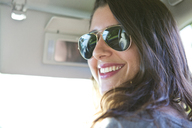 Portrait of woman wearing sunglasses while sitting in car - CAVF05906