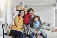 Portrait of happy family with two kids at home - RORF01186