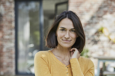 Portrait of confident woman in front of her home - RORF01195