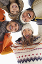 Low angle portrait of happy friends in huddle - CAIF12349