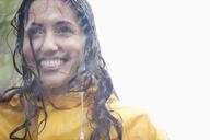 Smiling woman in rain - CAIF12433